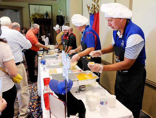 Don Knight   The Herald Bulletin<br /> Representing the Elwood school system, Ted Rutowski serves Buffalo Chicken Dip during the sixth annual Community Chefs event at the Anderson Country Club on Saturday.