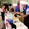 Don Knight | The Herald Bulletin<br /> Representing the Elwood school system, Ted Rutowski serves Buffalo Chicken Dip during the sixth annual Community Chefs event at the Anderson Country Club on Saturday.