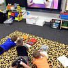 John P. Cleary | The Herald Bulletin<br /> Students from Samantha Smith's Summitville Elementary School kindergarten class stretch out on the floor as they watch, and follow a video showing the proper way to hold a pencil or crayon and teaching cursive writing.