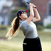 John P. Cleary | The Herald Bulletin<br /> Daleville's Emma Allen follows her approach shot to the seventh green at Yule Golf Course Monday during their match against Alexandria.