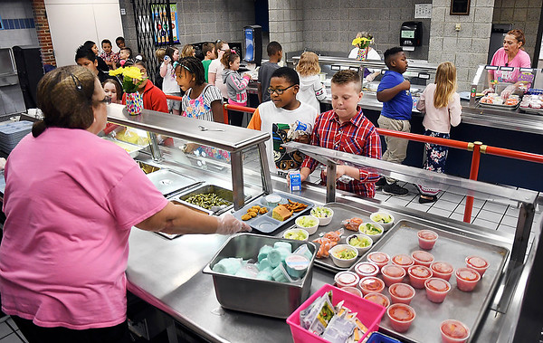 John P. Cleary | The Herald Bulletin<br /> Fourth graders go through the line in the cafeteria at Valley Grove Elementary School on a recent Friday to get their lunch of lasagna, chicken nuggets, or hamburgers.