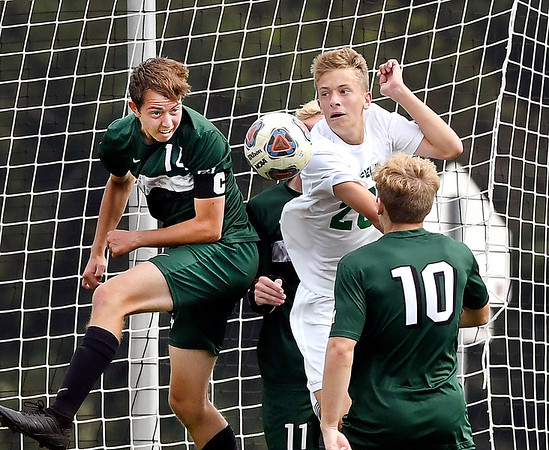 John P. Cleary | The Herald Bulletin<br /> Pendleton's Daniel Aker and Westfield's Ben Wallace go after the ball from a corner kick in front of the Westfield goal.