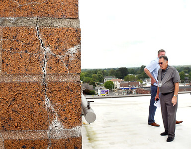 John P. Cleary | The Herald Bulletin Al Epperly, Madison County property manager, and Madison County Administrator Tim Westerfield, look over the bricks on the clock tower on the roof of the courthouse where cracks have formed on the structure.