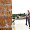 John P. Cleary | The Herald Bulletin<br /> Al Epperly, Madison County property manager, and Madison County Administrator Tim Westerfield, look over the bricks on the clock tower on the roof of the courthouse where cracks have formed on the structure.