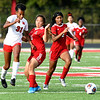 John P. Cleary | The Herald Bulletin<br /> Anderson's Juli Thatch and Anya Stephens go after the ball as Richmond's Jayci Allen, left, tries to gain position on them.