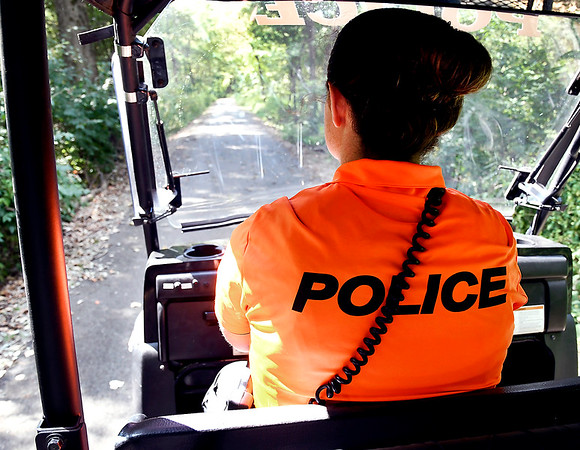 John P. Cleary   The Herald Bulletin<br /> In her bright orange polo,APD officer Courtney Skinner patrols the trails in a mule around the city.
