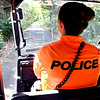 John P. Cleary | The Herald Bulletin<br /> In her bright orange polo,APD officer Courtney Skinner patrols the trails in a mule around the city.