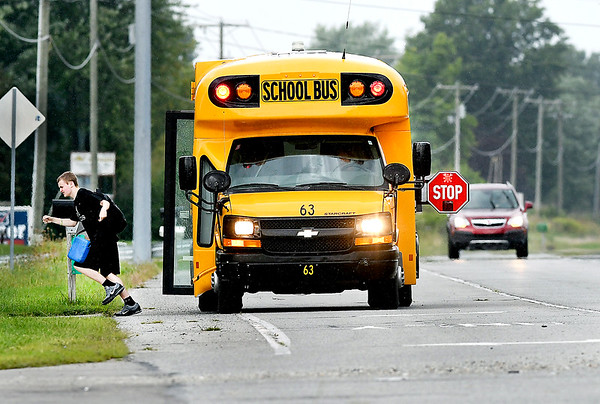 John P. Cleary | The Herald Bulletin<br /> This school bus, from the Frankton-Lapel school district, drops off a student along Indiana 9 as Madison County Sheriff's deputies monitor the route for any stop arm violators.
