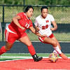 John P. Cleary | The Herald Bulletin<br /> Anderson's Cristal Medina fights for position to gain control of the ball against Richmond's Nakala Bennett during their match Tuesday evening.