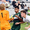 John P. Cleary | The Herald Bulletin<br /> Pendleton's Levi Rodriguez, center, and Westfield's Miguel Ayala, right, fight the the ball as Westfield's goalie, Aidan Huddleston comes into the fray to try to get control of the ball.