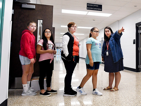 John P. Cleary | The Herald Bulletin<br /> Anderson Intermediate School fifth-grade teacher Elisabeth Reed points her students toward the restrooms and water fountain on the first day of classes at Anderson Intermediate School, July 31, 2019.