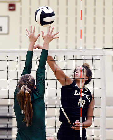 John P. Cleary | The Herald Bulletin<br /> Lapel's Delany Peoples, right, tips the ball over the out reached hands of Pendleton's Aubrey Helpling.