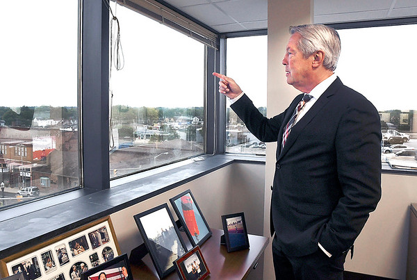 John P. Cleary | The Herald Bulletin<br /> Madison County Prosecutor Rodney Cummings points out the old neighborhood he grew up in from his third-floor office in the courthouse.