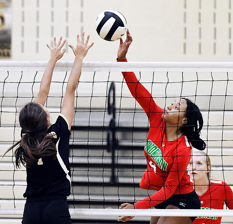 John P. Cleary | The Herald Bulletin<br /> Anderson's Tiara Ingram, right, tips the ball over the net as Lapel's Emma Jackley tries to block.
