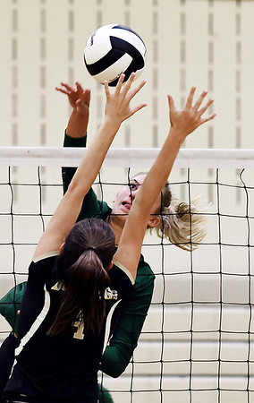 John P. Cleary | The Herald Bulletin<br /> Pendleton's Gracie King spikes the ball over Lapel's Zoe Freer.