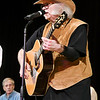 John P. Cleary | The Herald Bulletin<br /> Dan Daughtery plays his guitar at the Little Bit Country Jamboree. After having his left hand and arm crushed several years ago, doctors said he would never be able to play the guitar again but he's back strumming with the Cops & Robbers Band.
