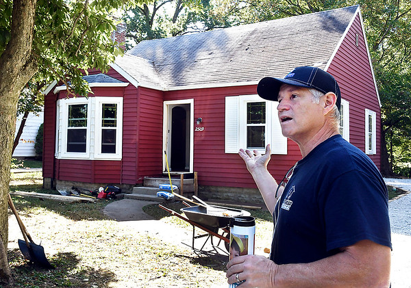 John P. Cleary   The Herald Bulletin<br /> Jim Grueser, owner of Big Head Industry, tells about what they have done to this house on West 11th Street they are remodeling that has been vacant for 10 years on West 11th Street in Anderson.