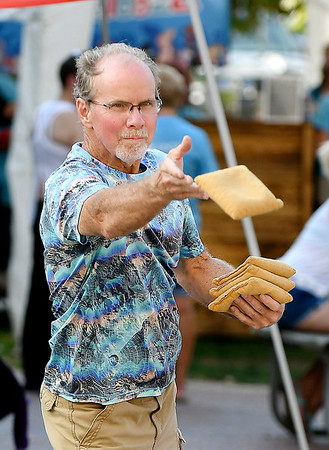 John P. Cleary | The Herald Bulletin<br /> Paul Keesling takes aim as he lets his beanbag fly while competing in the cornhole tournament at the Animal Protection League's Pawapalooza at Dickmann Town Center Saturday afternoon.