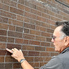 John P. Cleary | The Herald Bulletin<br /> Al Epperly, Madison County property manager, points out cracks in the bricks in the clock tower on the roof of the courthouse.