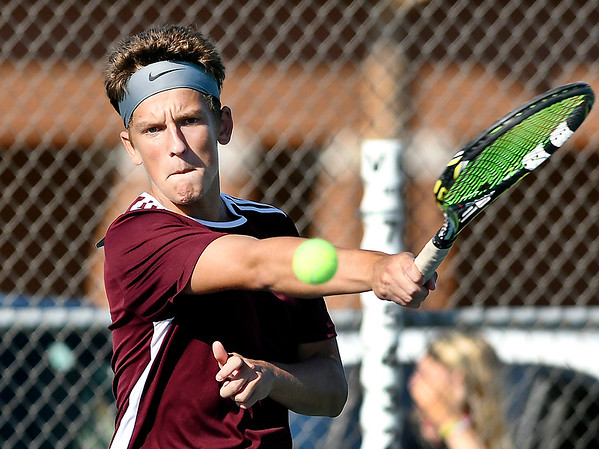 John P. Cleary | The Herald Bulletin<br /> Alexandria's one seed singles player, Trevor Simison, makes a return during his match against Frankton's Jacob Davenport.