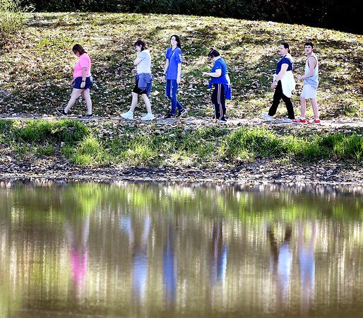 John P. Cleary | The Herald Bulletin<br /> It was a nice day to get out and take a walk like this group was doing Thursday morning, strolling around the pathways at Pulaski Park