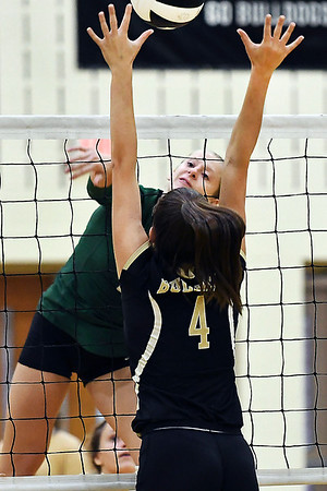 John P. Cleary | The Herald Bulletin<br /> Pendleton's Avery Ross gets one of her 21 kills as Lapel's Zoe Freer tries to defends.