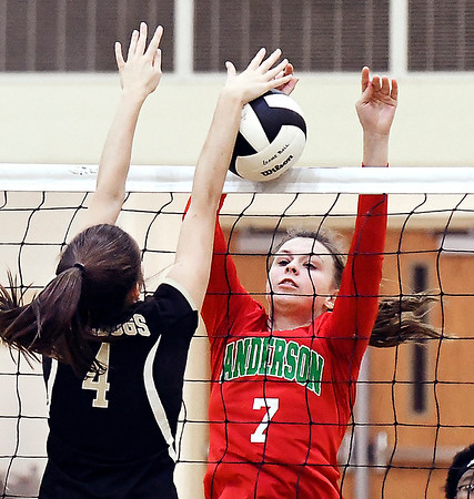 John P. Cleary | The Herald Bulletin<br /> Lapel's Zoe Freer and Anderson's Taylor Webber each battle to get the ball over the net during their match Wednesday.