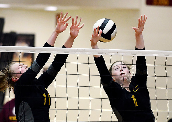 John P. Cleary | The Herald Bulletin<br /> Alexandria's Olivia Hall and Kaitlyn Bair try to block a shot but just got a finger on it.