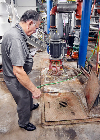John P. Cleary | The Herald Bulletin<br /> Al Epperly, Madison County property manager, looks over the rusting and warping cover over a pit  for the air conditioning system in the basement of the courthouse.