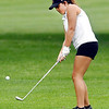 John P. Cleary | The Herald Bulletin<br /> Alexandria's Kelsey Rhoades chips on to the seventh green.
