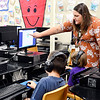 John P. Cleary | The Herald Bulletin<br /> Daleville Elementary School first-grade teacher Maleah Parrish helps one of her students as they work with a reading tutorial in the computer lab Monday.