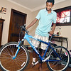 John P. Cleary | The Herald Bulletin<br /> De'Shawn Nance, 16, shows off the new bike that a stranger bought for him after hearing about his accident on social media.