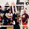 John P. Cleary | The Herald Bulletin<br /> Alexandria's Lauren Dungan atempts a kill over Raider defender Macie Bowden.