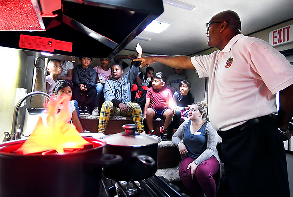 Deputy Fire Chief Wilbert Kelly asks a question of Lisa Hartsook's Anderson Elementary third grade class about fire safety in the home while inside Anderson Fire Department's new fire safety trailer. AFD made their first field trip Thursday with the trailer to the school to teach students about fire safety and how they can survive in their home.