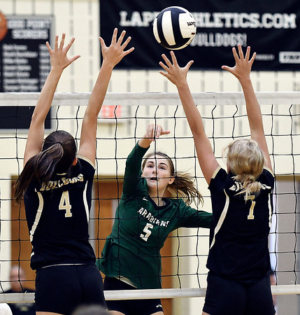 John P. Cleary | The Herald Bulletin<br /> Pendleton's Gabrielle Ennis gets her shot over the reach of Lapel's defenders, Zoe Freer and Lexi Anderson.