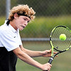 John P. Cleary | The Herald Bulletin<br /> Lapel's no. one singles player, Jesse McCurdy, grimaces as he hits this shot against Shenandoah's Lance Holdren. McCurdy won his match 6-0, 6-0.