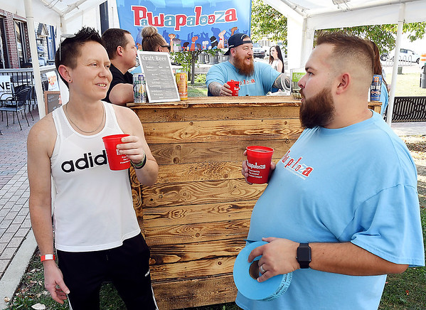 John P. Cleary | The Herald Bulletin<br /> Michele Rich and Chris Hiday enjoy a craft beer while attending the Animal Protection League's Pawapalooza at Dickmann Town Center Saturday.