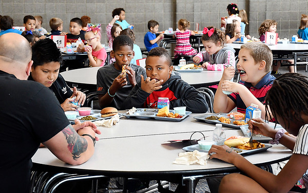 John P. Cleary | The Herald Bulletin<br /> Fourth graders enjoy their lunch at Valley Grove Elementary School on a recent Friday with their choice of lasagna, chicken nuggets, or hamburgers.