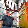 John P. Cleary | The Herald Bulletin<br /> Milke Shuter, of Shuter Sunset Farms, checks the control panel for the grain silos.