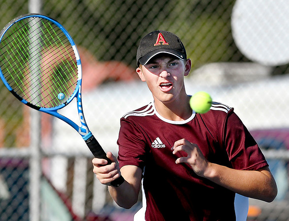 John P. Cleary | The Herald Bulletin<br /> Alexandria's one seed singles player Trevor Simison returns a shot during his match against Frankton's Jacob Davenport.