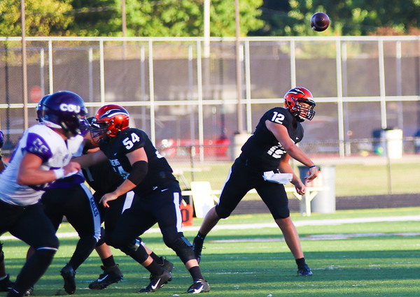 Chris Martin for The Herald Bulletin.  Ravens quaterback Tyson Harley competes a pass Saturday at home against Cincinnati Christian.