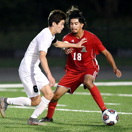 John P. Cleary | The Herald Bulletin<br /> Pendleton's Kai Moore and Anderson's Alan Olguin fight for possession.