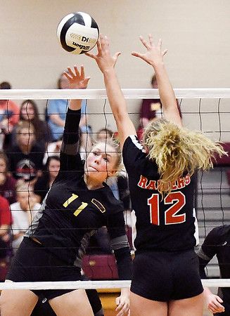 John P. Cleary | The Herald Bulletin<br /> Alexandria's Olivia Hall gets her shot over the net as Wapahani's Camryn Wise just gets a fingertip on the ball trying to defend.