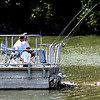 John P. Cleary | The Herald Bulletin<br /> With the humidity down and the temperatures above normal, it was a good day to sit at the end of the pier with several fishing lines out in the water enjoying a beautiful day like this couple at Shadyside Park Thursday afternoon.