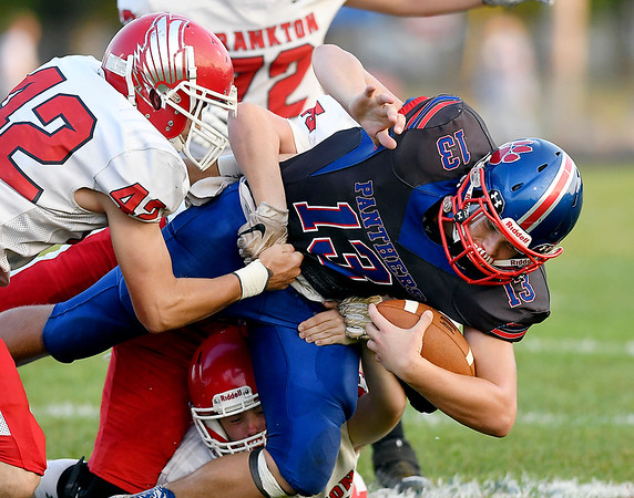 John P. Cleary | The Herald Bulletin<br /> Elwood's Colton Jetty is brought down by several Frankton defenders.