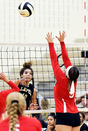 John P. Cleary | The Herald Bulletin<br /> Lapel's Delany Peoples takes her shot across the net as Anderson's Lauryn Williams tries to defend.