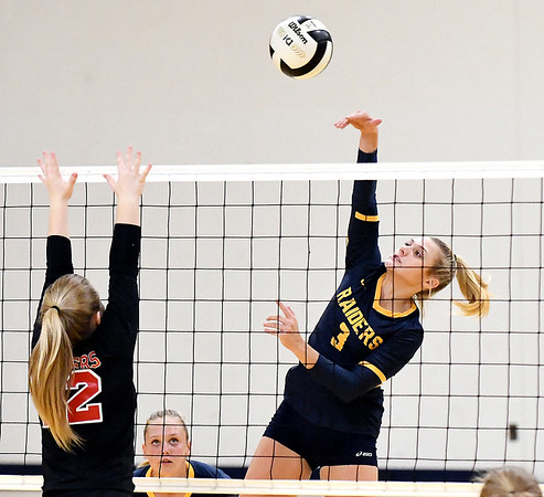 John P. Cleary   The Herald Bulletin<br /> Shenandoah's Kenedi Helms, right, attempts a kill against Wapahani during the  JV match.