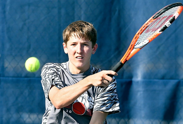John P. Cleary | The Herald Bulletin<br /> Frankton's #1 singles player, Jacob Davenport, follows his shot during his match against Shenandoah.