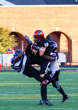 Chris Martin for The Herald Bulletin. Anderson receiver Alex Barnett goes up in the air to grab a pass against two Cincinnati Christian defenders Saturday at home.