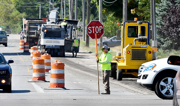 John P. Cleary | The Herald Bulletin Workers from D C Paving mill down Cross Street west of Broadway Wednesday afternoon. They will be resurfacing Cross Street from Broadway to Indiana Avenue.